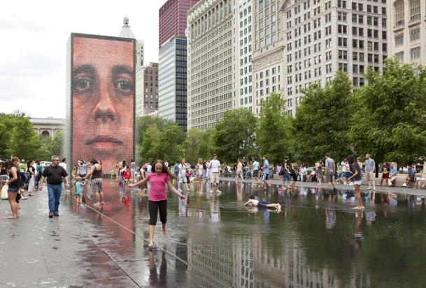 Children play in water of the Crown Fountain located in Millennium Park in downtown Chicago.