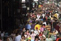Crowds begin to form on Bourbon Street on Mardi Gras day, in New Orleans, Louisiana.