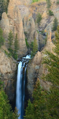 Unusual pinnacles of rock stand above the dizzying heights of Tower Falls, Yellowstone National Park.