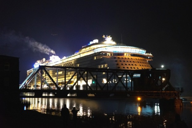 Royal Caribbean's Ovation of the Seas passes the Weener Bridge during her conveyance down the River Ems.