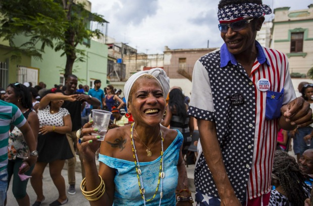 Two Cubans smile widely as they take part in a weekly rumba dance gathering in Havana, Cuba.