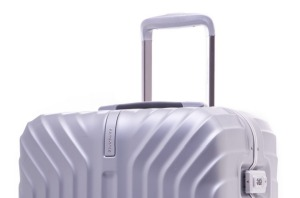The Samsonite Tru-Frame features a trolley system and handle in the same colours as the case.