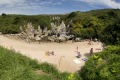 Gulpiyuri Beach, Spain. What is a sandy beach doing in the middle of a meadow, 100 metres from the sea? Gulpiyuri ...