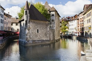 View of the former prison surrounded by canals in Annecy, France.