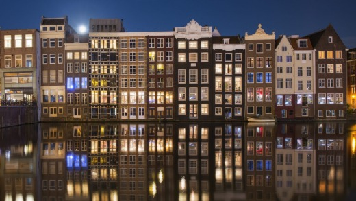 A row of disinctive, traditional canalhouses, Amsterdam.