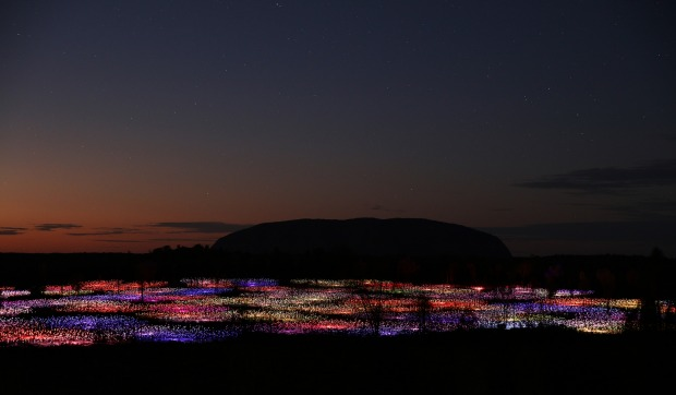 Bruce Munro's 'Field of Light' at Uluru. Composed of 50,000 stems that hold different shades of coloured light, the ...