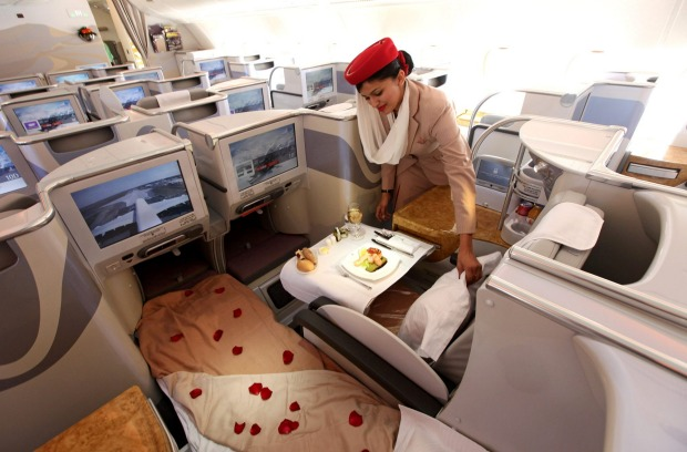 A stewardess adjusts a pillow in the business class section of an Emirates Airbus A380.