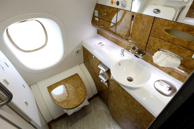 Glossy wood decorates a bathroom in the business class section of an Emirates Airbus A380.