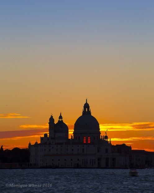 Venice, Italy. Beautiful view of the setting sun whilst travelling in Venice by public transport.