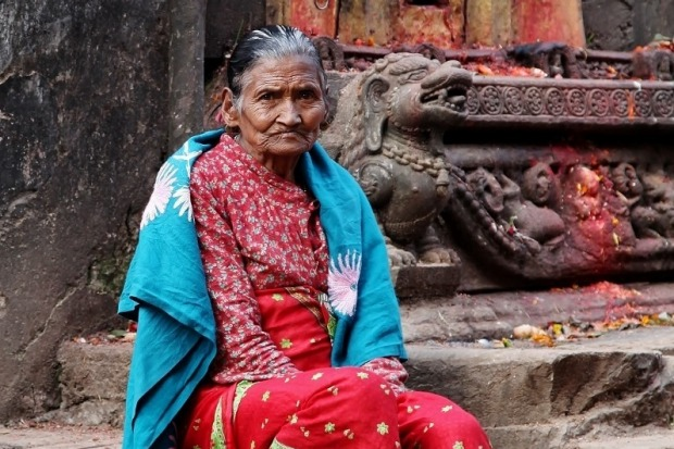 I spotted this lady selling her vegetables in Bhaktapur, Nepal. She was seated on some steps across a busy road and I ...