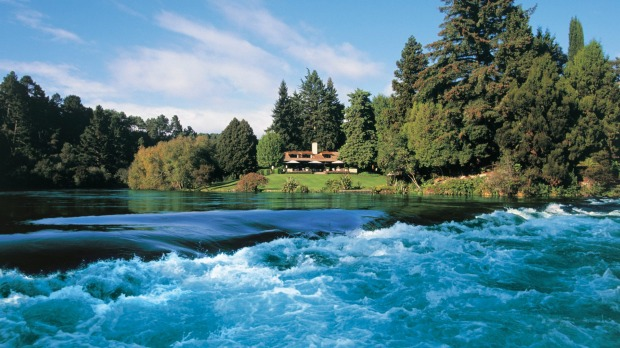 Huka Lodge in Taupo, New Zealand, sits above the mighty Waikato River.