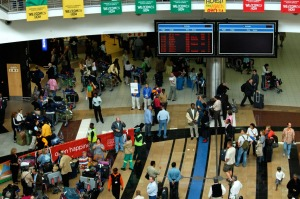 Travellers in the arrival hall of the O.R. Tambo International Airport (ORTIA) in Johannesburg, South Africa.