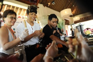 Ubud chef Made Lugra makes sate lilit, a popular local seafood sate, with his audience.