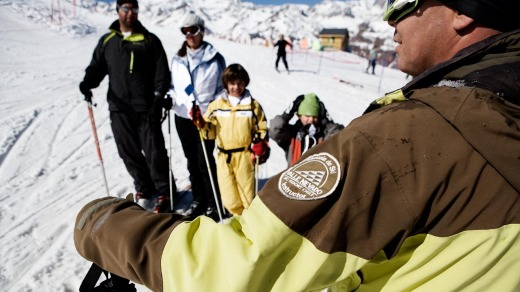 A ski instructor leads a group at Valle Nevado.