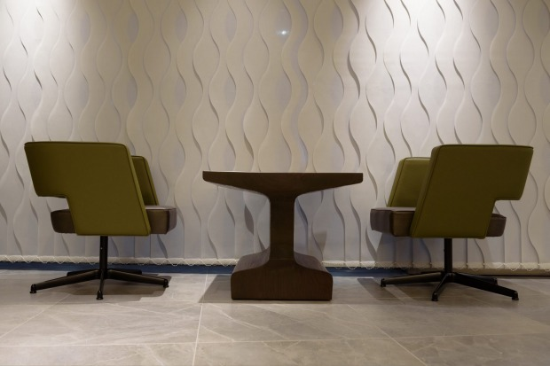 Chairs and a table sit in the View Gold Lounge, operated by East Japan Railway Company and View Card, at the Tokyo ...