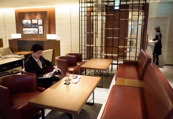 A customer rests in the View Gold Lounge, operated by East Japan Railway Company and View Card, at Tokyo Station in ...