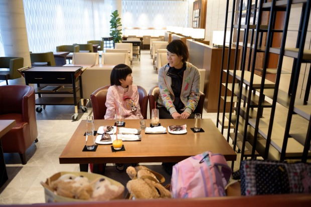 A woman and her daughter relax in the View Gold Lounge, operated by East Japan Railway Company and View Card, at Tokyo ...
