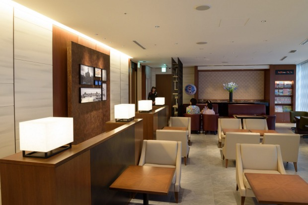 People sit in the View Gold Lounge, operated by East Japan Railway Company and View Card, at Tokyo Station in Tokyo, ...