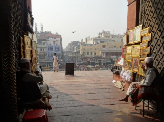 Peering out from the calm of Jama Masjid to the hubbub of old Delhi.