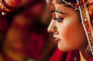 A groom puts 'sindoor' (holy red color) on the bride's forehead as per the wedding custom in Jodhpur, Rajasthan.