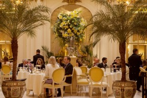 People having afternoon tea in Palm Court, the Ritz Hotel, London.