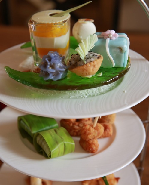 Afternoon tea at The Mulia, Bali. Scones and cupcakes are on the high tea menu at ZJ's Bar and Lounge at The Mulia in ...