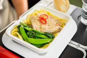 Barramundi poached in a lightly spiced coconut sauce with noodles, sugar snaps, choy sum and chilli on a Qantas flight.