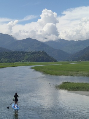 Stand-up paddleboarding with Himalayan Yogini in Nepal.