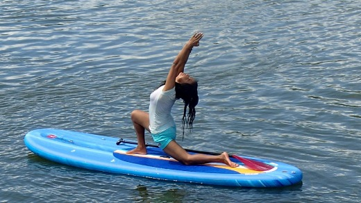 A yoga session on a stand-up paddleboard on Phewa Lake, Pokhara, Nepal.