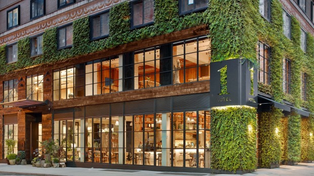 The hotel's three-storey facade is covered in ivy.