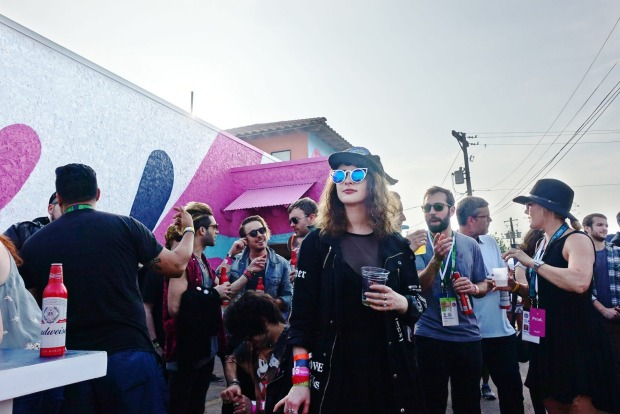 Music fans in the crowd at Spotify House, which is one of over 100 official gig venues dotted throughout the centre of ...