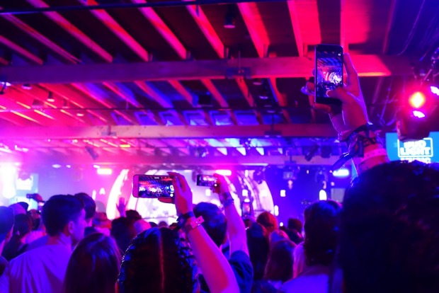 Fans video a performance by AlunaGeorge on their smartphones at Brazos Hall. For  the duration of South by Southwest the ...