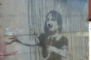 """Rain Girl"" – one of three remaining Banksy portraits in New Orleans."