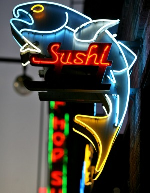 A neon sushi sign in Little Tokyo, Los Angeles.