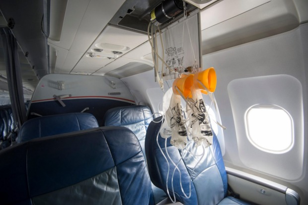 Drop-down oxygen masks are activated should cabin pressure drop.