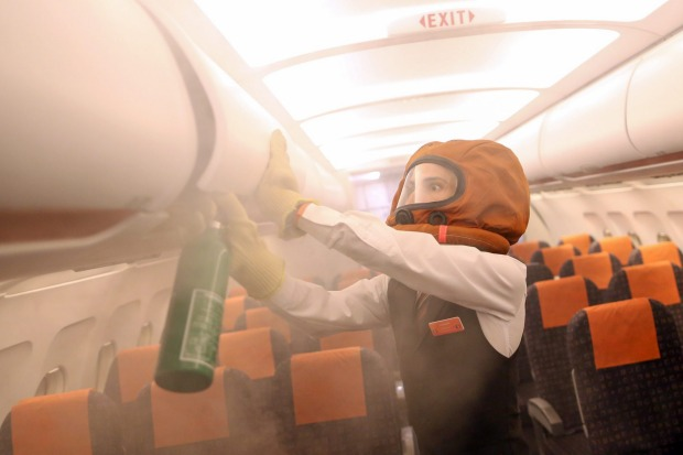 Handheld fire extinguishers are provided on aircrafts for manual firefighting. An easyJet crew member takes part in a ...
