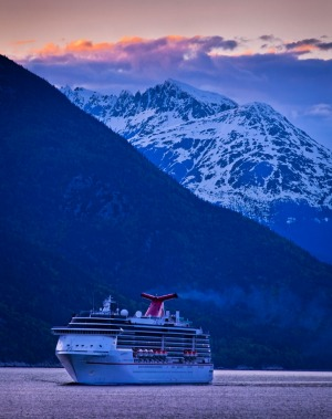 Carnival Cruise Spirit sailing through Lynn Canal at sunset, near Haines, Inside Passage, Southeast Alaska.