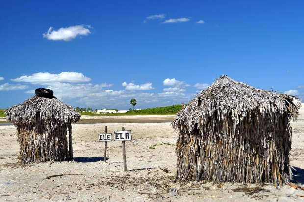 Two toilets made of palm tree leaves, Brazil.