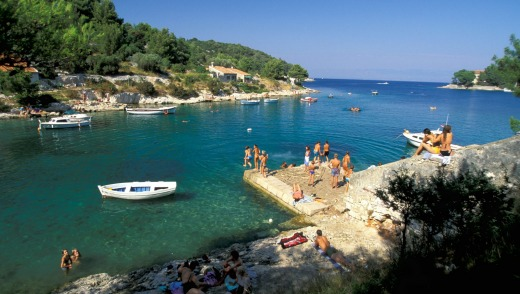 Beach fun in the Punta Bay, Losinj island.