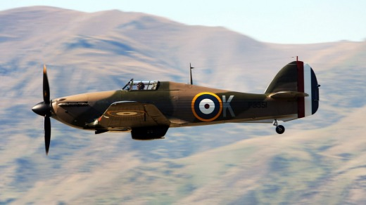 A WWII Hawker Hurricane fighter takes part in a mock battle during a Warbirds Over Wanaka airshow.