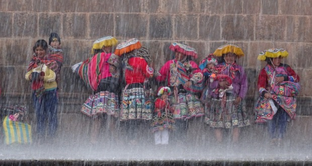 Cusco, Peru. A sudden rain storm in Cusco Peru meant that everyone had to run for cover. I spotted these gorgeous women ...