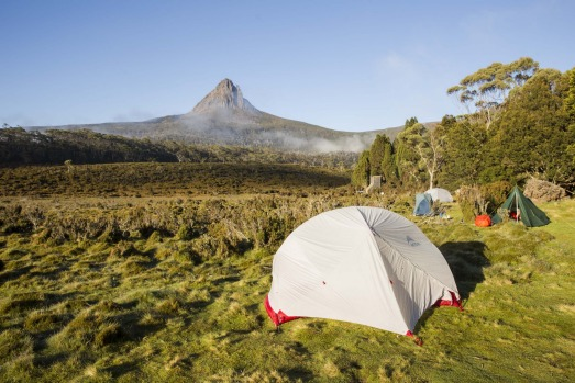 First campsite on the Overland Track in Tasmania, overlooking the early morning fog over Barn Bluff. An iconic ...