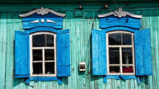 Blue window shutters in Ulan Ude, Siberia, Russia.