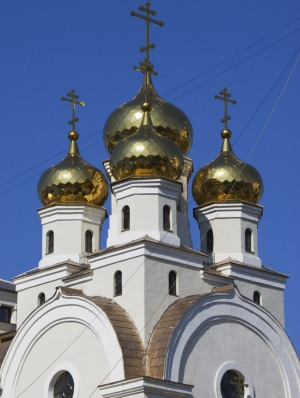 Golden domes of small Orthodox Church (next to Church of the Blood) at the Romanov Death Site, Russia.