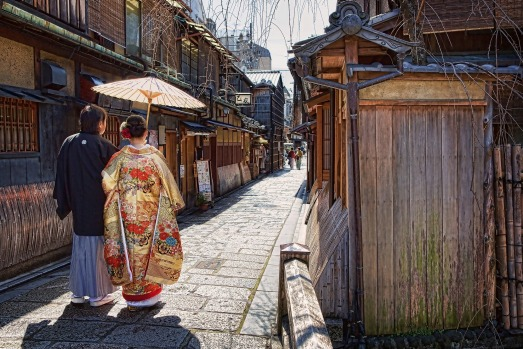 Springtime in the Gion district of Kyoto, Japan when locals dress in traditional costume and enjoy walking through the ...
