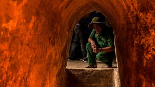 A Vietnamese tour guide sits inside the Cu Chi tunnels, on the outskirts of Ho Chi Minh City.