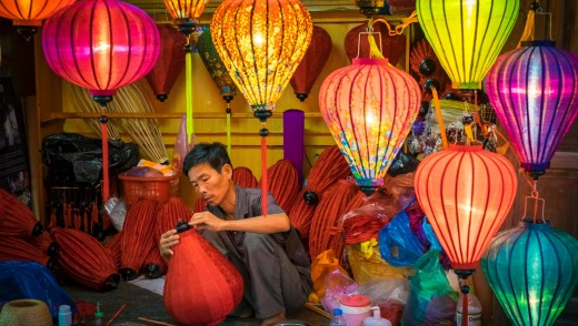 A man makes silk lanterns in his workshop, Hoi An, Vietnam.