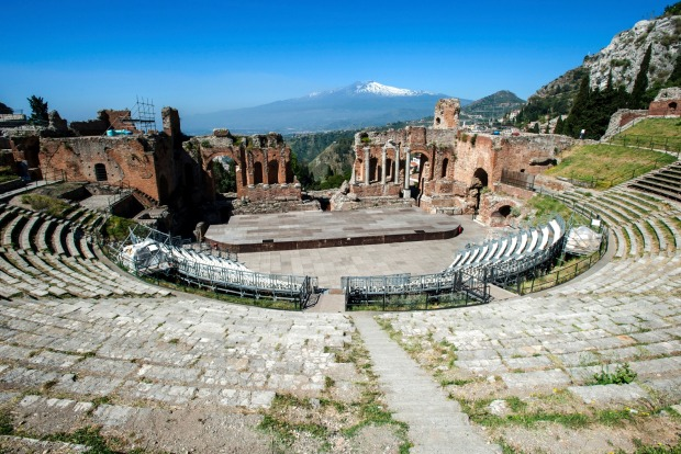 Greek theatre, Taormina, Italy: Many Greek theatres are larger and better preserved, but Taormina's sits in a dazzling ...