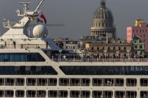 Passengers stand on Carnival's Adonia cruise ship as they arrive.