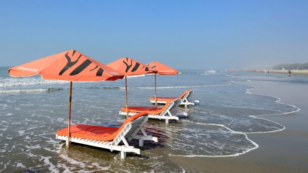 Want a beach free of tourists? Try Bangladesh. Pictured: The fishing port and sea resort of Cox's Bazar.